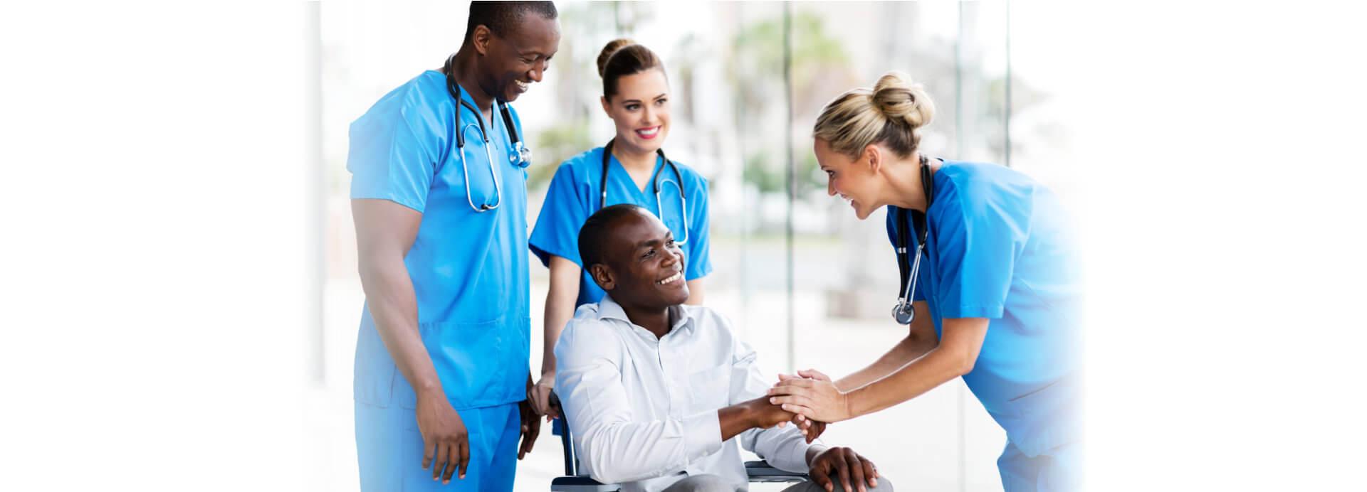 black man asisted by nurses