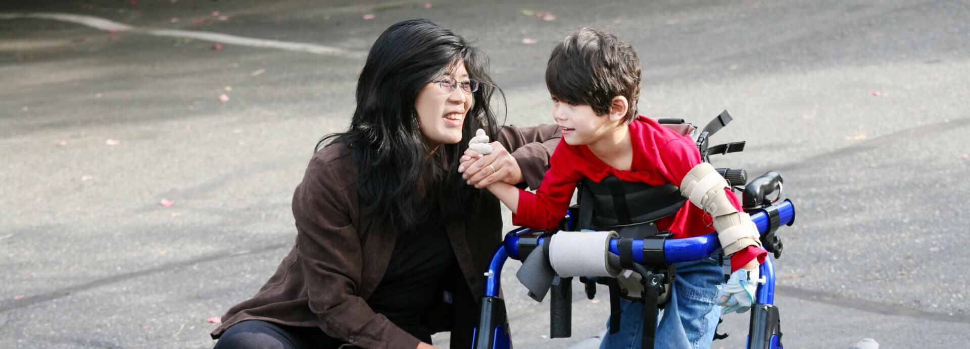 A lady assisting a disable child