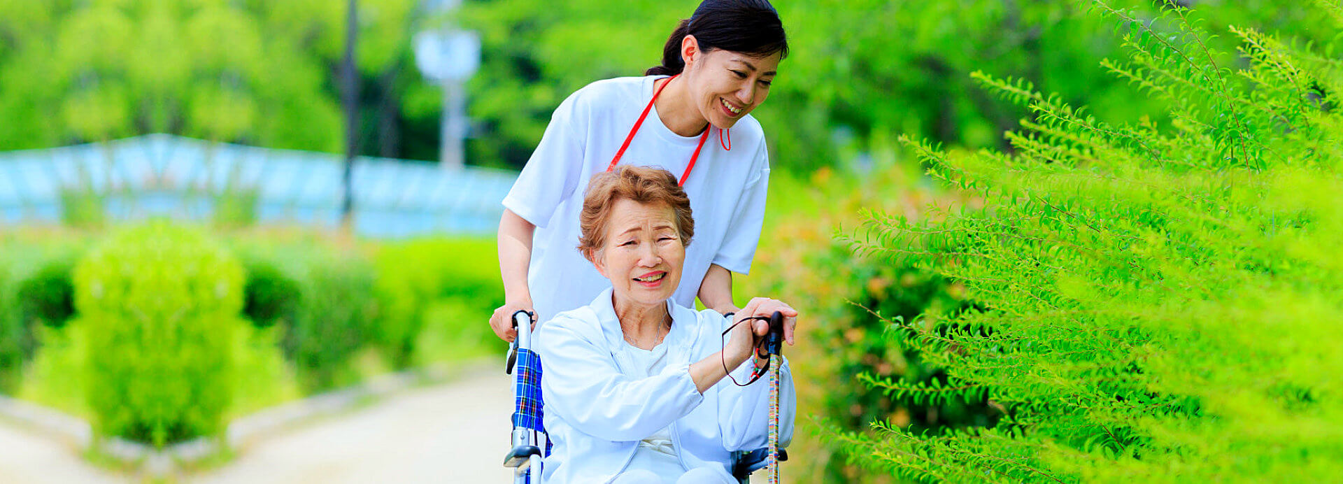 elderly woman on wheelchair with the staff